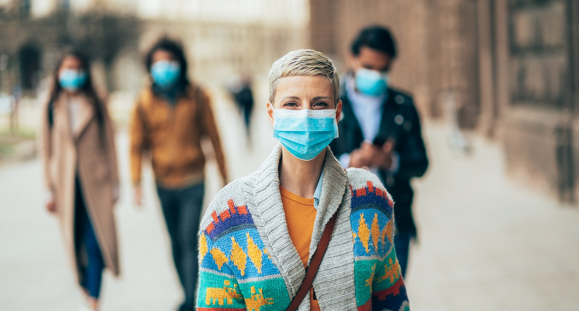 Lady in street with a face mask on