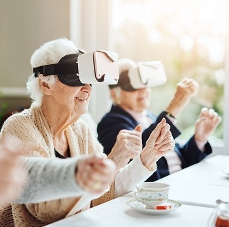 ladies in a care home with Virtual reality goggles on